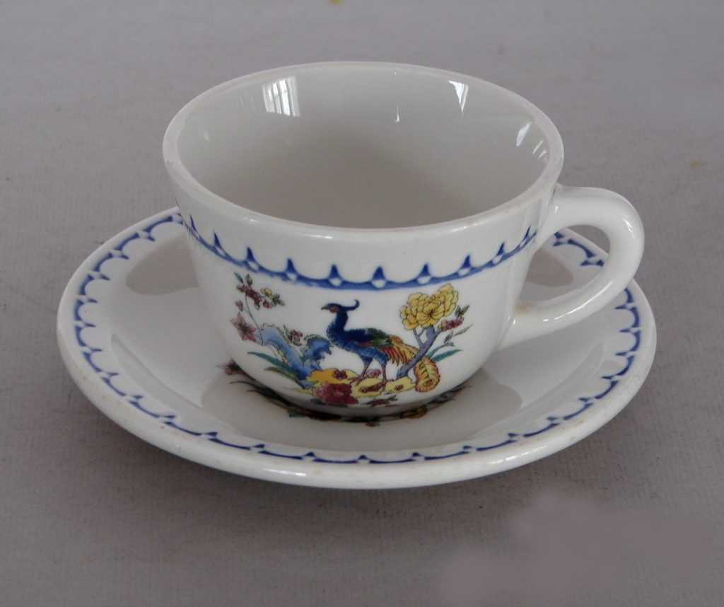 """Milwaukee Peacock"" - This is an ""exclusive"" pattern: The Chicago, Milwaukee, St. Paul & Pacific bought the right to exclusive use of this pattern from Syracuse China, which agreed to sell it to no other customers. An important note is that the rights they bought included the bird with this blue scallop edge design only! For it to be authentic railroad china, a piece MUST include both the blue scallops and the peacock. Another important note is that ""exclusive"" patterns usually never carry railroad markings."