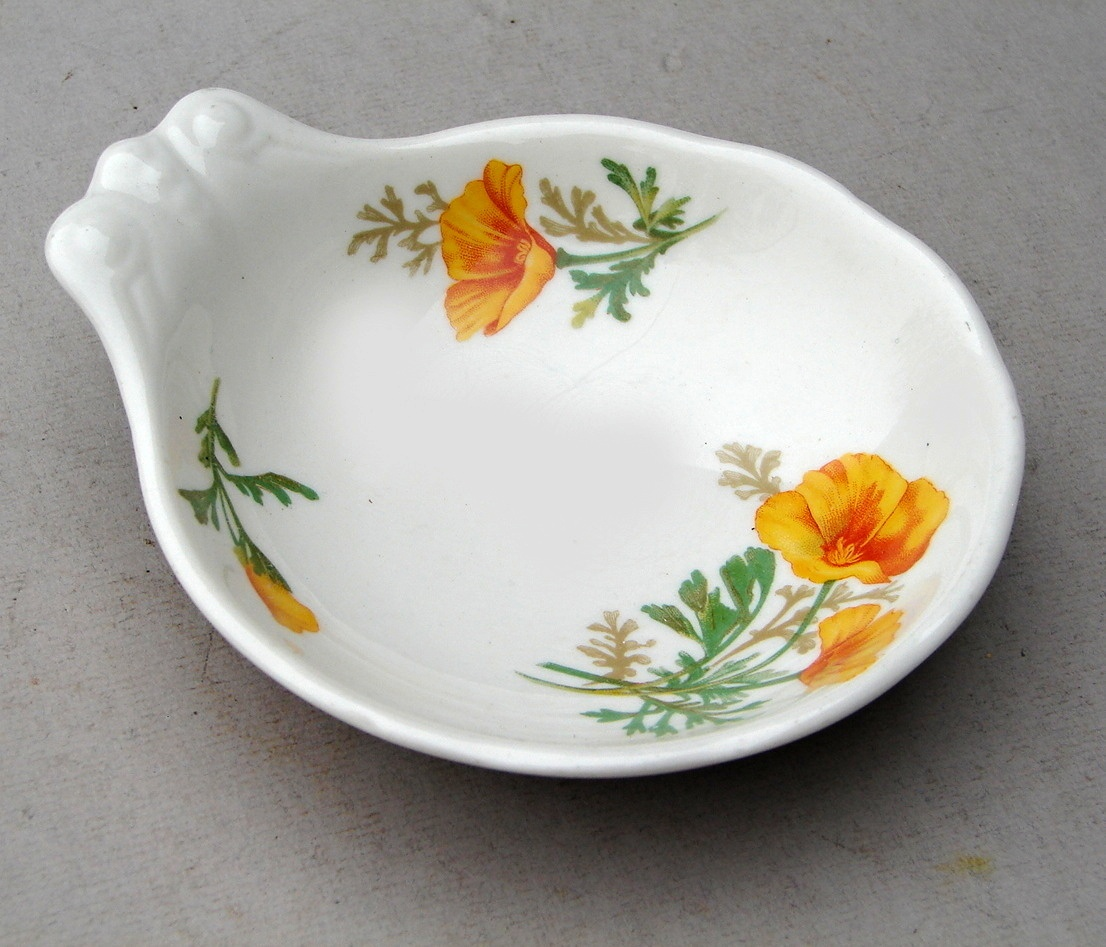 """California Poppy"" - This pattern was made for the Santa Fe Railroad both with and without railroad markings on the underside. Another ""exclusive"" pattern, it is railroad china ONLY in the heavyweight version. Household ""thin"" dinnerware was not part of the exclusive agreement, and Syracuse China made and sold the thin version to any customer."