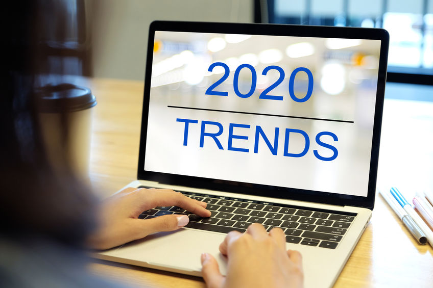 2020 online selling trends, Woman hand tying laptop computer with 2020